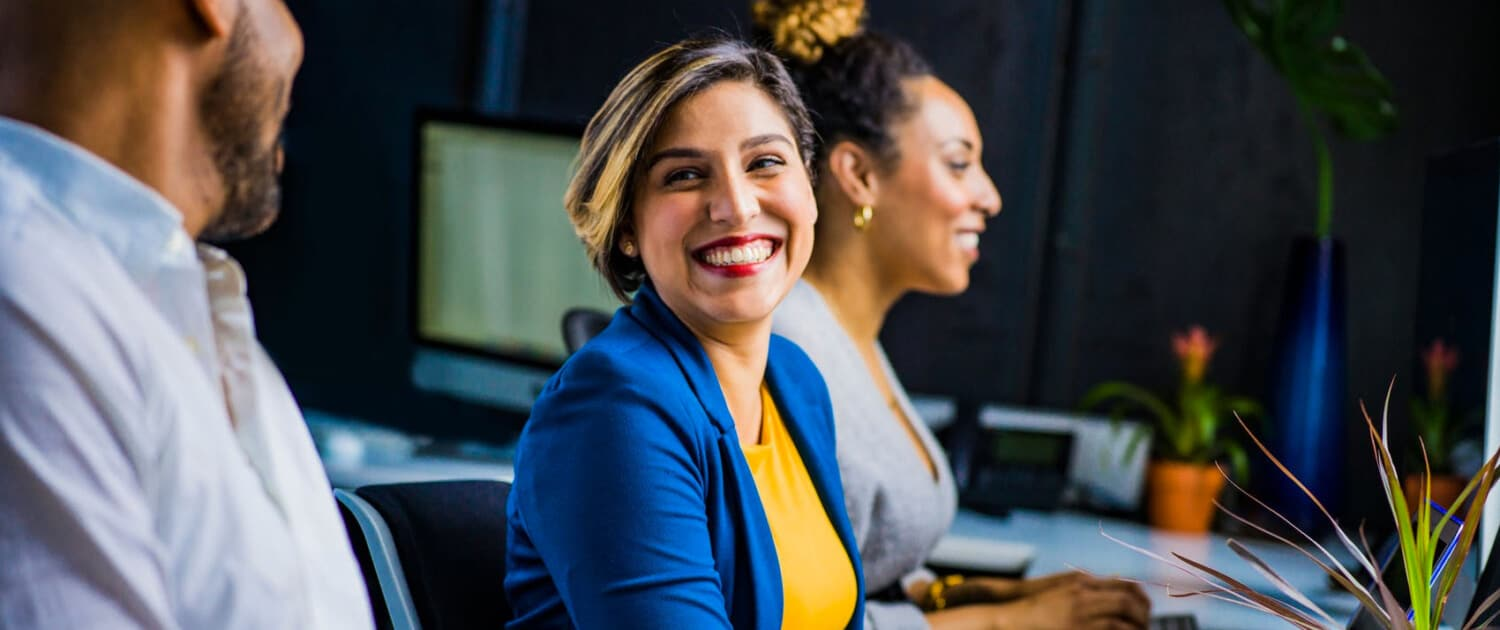 client smiling to other people about her success