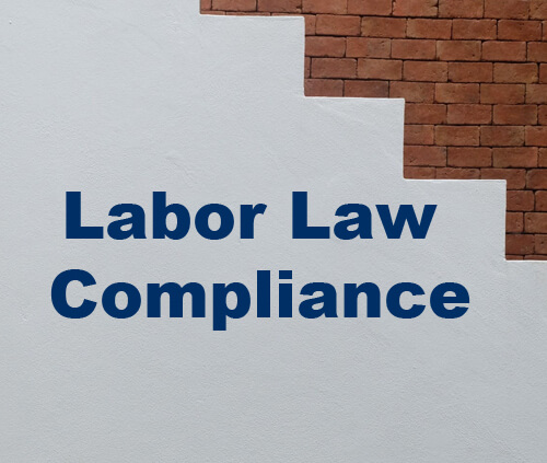 Labor Law Compliance text on white background with stair step brick pattern