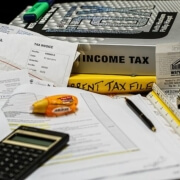 taxes filing books and papers with calculator and invoices