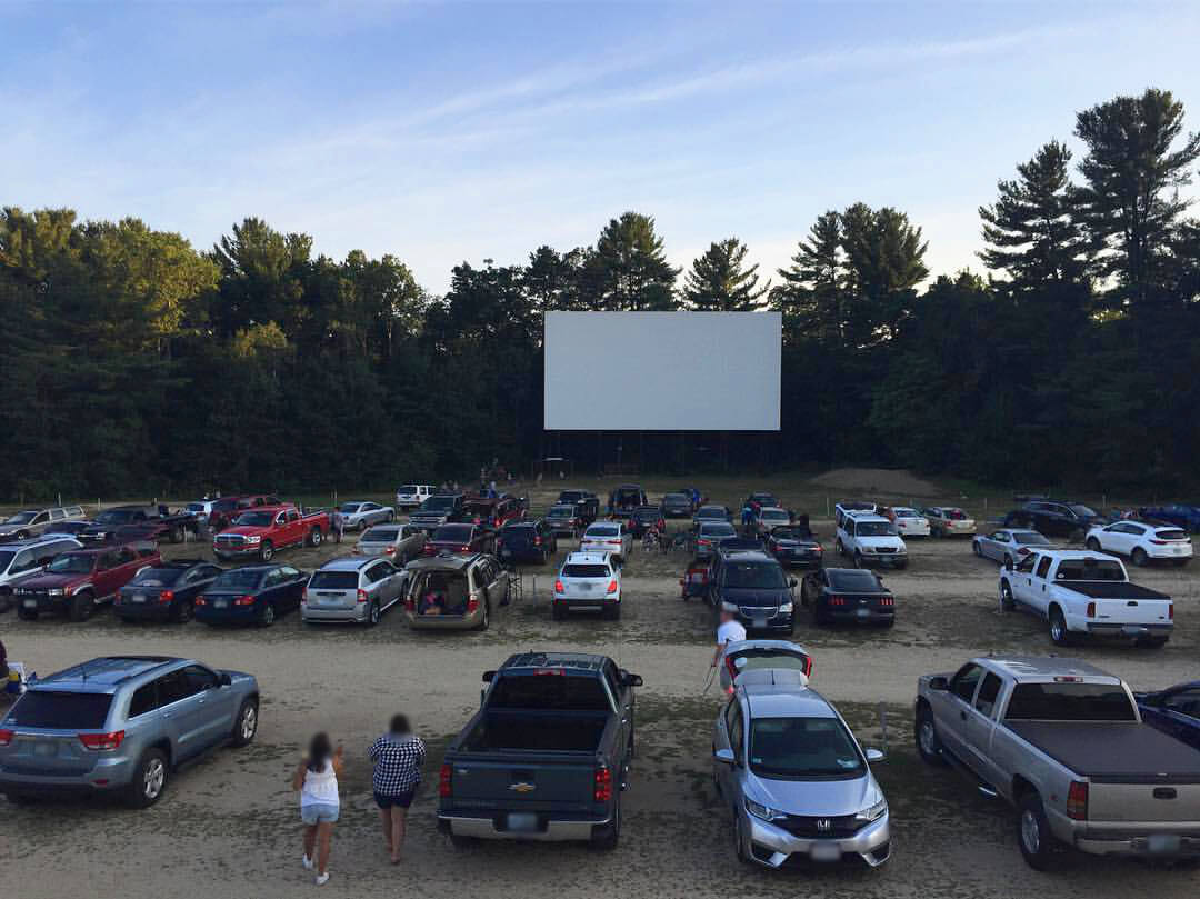 Drive-In-Theater with cars in the foreground