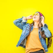 Yellow background, happy woman in sunglasses